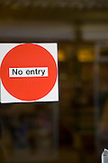 No entry sign on glass door