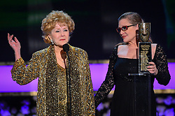 December 27, 2016 - File - CARRIE FRANCES FISHER (October 21, 1956 - December 27, 2016) was an American actress, screenwriter, author, producer, and speaker. She was known for playing Princess Leia in the Star Wars films. Fisher was also known for her semi-autobiographical novels, including Postcards from the Edge, and the screenplay for the film of the same name, as well as her autobiographical one-woman play, and its nonfiction book, Wishful Drinking, based on the show. Her other film roles included Shampoo (1975), The Blues Brothers (1980), Hannah and Her Sisters (1986), The 'Burbs (1989), and When Harry Met Sally (1989). Pictured: Jan. 25, 2015 - Los Angeles, California - Carrie Fisher presents her mother, Debbie Reynolds, with the lifetime achievement award at the 21st Annual Screen Actors Guild Awards telecast at the Shrine Auditorium in Los Angeles, California on Sunday January 25, 2014. (Credit Image: © Michael Owen Baker/Los Angeles Daily News/ZUMA Wire)