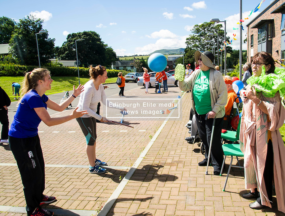Pictured: Surrene Baker was on top form in the sun<br /> <br /> First-ever care home games tournament took place over two days at Edinburgh's Inchview Care home. More than 90 athletes from other care homes gathered to  compete in events including javelin, curling and dancing. <br /> <br /> <br /> <br /> Ger Harley   EEm 27 July 2016