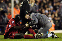 Photo: Glyn Thomas.<br />Birmingham City v Liverpool. The FA Cup. 21/03/2006.<br /> Liverpool's Djimi Traore (L) receives treatment for an injury, and is substituted shortly afterwards.