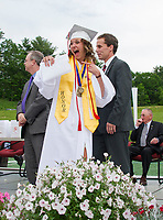 Taylor Lovely shows off her diploma during Laconia High School Commencement Ceremony Friday evening.  (Karen Bobotas/for the Laconia Daily Sun)