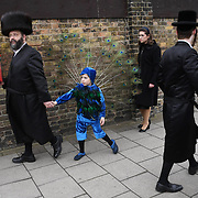 Members of the Jewish Community celebrate the festival of Purim in Stamford Hill north London, Britain, 21 March 2019. Purim is a Jewish holiday that commemorates the saving of the Jewish people from Haman according Biblical Book of Esther. Families often dress in colourful costume and share gifts. Stamford Hill in north London has the largest concentration of ultra-orthodox Charedi Hasidic Jews in Europe