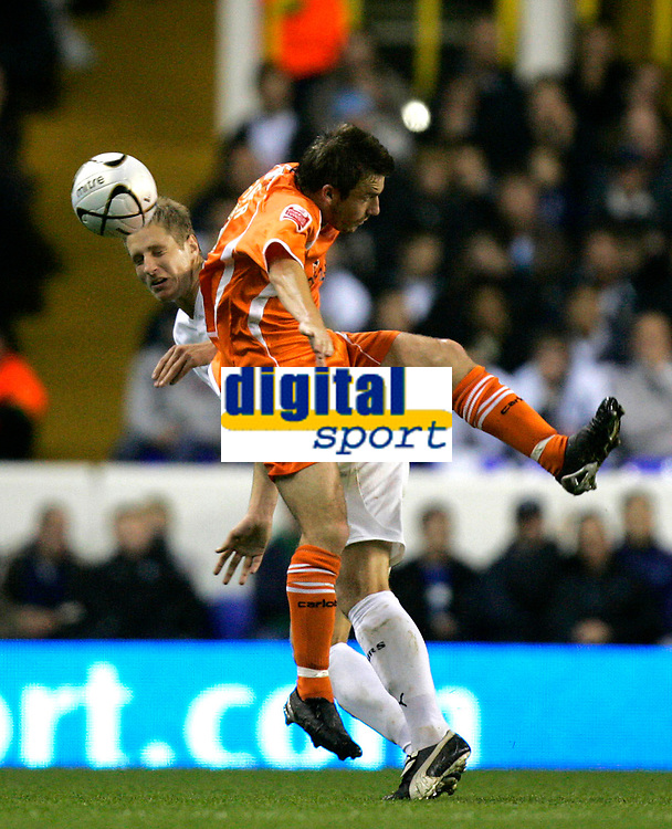 Photo: Tom Dulat.<br /> <br /> Tottenham Hotspur v Blackpool. Carling Cup. 31/10/2007.<br /> <br /> Keigan Parker of Blackpool and Michael Dawson of Tottenham Hotspur head for the ball.