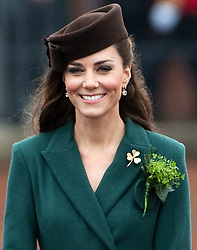 © London News Pictures. 17/03/2012. Aldershot, UK. The Duchess of Cambride CATHERINE (KATE) MIDDLETON wearing a shamrock broach and a sprig of shamrock after presenting traditional sprigs of shamrock to the 1st Battalion Irish Guards at Mons Barracks in Aldershot, Hampshire, UK,  on Saint Patrick's Day, March 17th, 2012.  Photo credit : Ben Cawthra/LNP.
