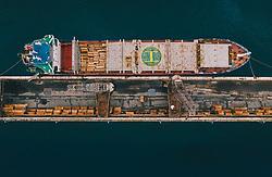 THEMENBILD - das Frachtschiff Manassa M beim Holz -Verladevorgang im Hafen, aufgenommen am 14. August 2019 in Rijeka, Kroatien // the Cargo ship Manassa M during the wood loading process in the harbour of Rijeka, Croatia on 2019/08/14. EXPA Pictures © 2019, PhotoCredit: EXPA/ JFK