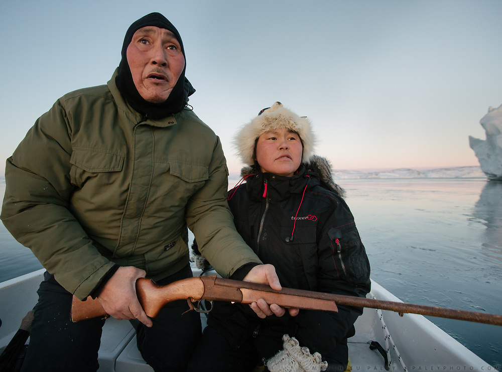 Inuit hunting by boat and with a rifle. Bent and Dina Ignatiussen. Life in and around the small Inuit settlement of Isortoq (population of 64), in East Greenland.