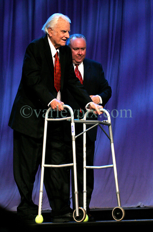 March 12th, 2006. New Orleans, Louisiana. <br /> Claiming this to be his last event preaching from the pulpit, the world's most famous evangelist, The Reverend Billy Graham is helped to the lectern as he prepares to address a capacity crowd at the New Orleans Arena as he brings his 'Celebration of Hope' weekend event to an end.<br /> Photo©; Charlie Varley/varleypix.com