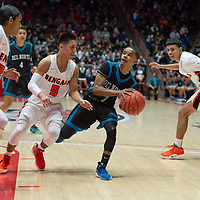 """Del Norte Knights Johnathan Wilkens (1) is surrounded by three Gallup Bengals defenders on a drive to the basket in the first quarter of the NMAA State Tournament. The Knights defeated the Bengals 55-49 at """"The Pit"""" in Albuquerque Wednesday evening."""