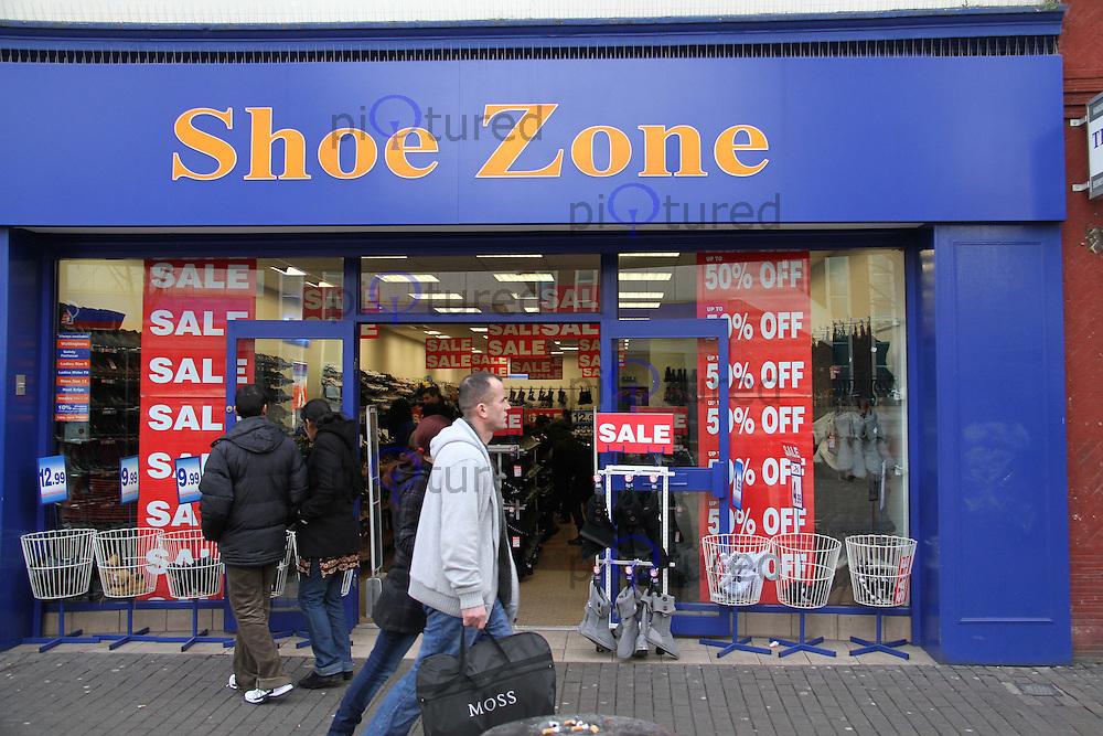 Boxing Day High Street Shops Sales, Hounslow High Street, London, UK, 26 December 2010:  Contact: Ian@Piqtured.com +44(0)791 626 2580 (Picture by Richard Goldschmidt)