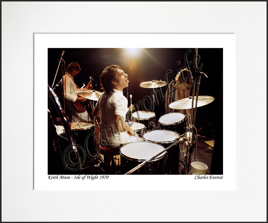 """Keith Moon - An affordable archival quality matted print ready for framing at home.<br /> Ideal as a gift or for collectors to cherish, printed on Fuji Crystal Archive photographic paper set in a neutral mat (all mounting materials are acid free conservation grade). <br /> The image (approx 6""""x8"""") sits within a titled border. The outer dimensions of the mat are approx 10""""x12""""."""