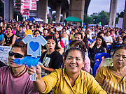 05 AUGUST 2013 - BANGKOK, THAILAND: Supporters of former Abhisit Vejjajiva, former Prime Minister of Thailand, applaud during while Abhisit speaks in Bangkok Monday. Abhisit spoke at a gathering of Thai Democrats in a working class neighbohood of Bangkok off of Rama VI Road. He spoke out against the Pheu Thai's amnesty efforts, which could lead to Thaksin Shinawatra returning to Thailand.     PHOTO BY JACK KURTZ