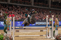 Connie Mensley riding Madonna wins the Mistletoe mini stakes during day seven of the London International Horse Show at London Olympia.