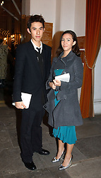 EDWARD TANG and VICTORIA TANG children of David Tang, at a wedding in London on 16th December 2003.PPR 5