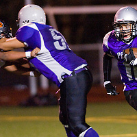 110912       Cable Hoover<br /> <br /> Miyamura Patriot Aaron Saucedo (10) carries the ball past the Gallup Bengal defense Friday at Public School Stadium.