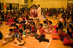 Children and young people watching the celebrations for Navratri; the Hindu festival of Nine Nights,