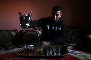 Unveiled soccer .Ibtissam brother is serving tea at Ibtissam's place .Ibtissam is considered to be one of the most promissing soccer athlet in Morocco .Thursday  , 14th January 2010 ,  Sidi-Moumen , outskirts of Casablanca , Morocco. (Photo Joao Henriques )