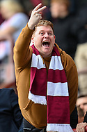 A Hearts fan gestures towards the Hibs fans during the Cinch SPFL Premiership match between Heart of Midlothian and Hibernian at Tynecastle Park, Edinburgh, Scotland on 12 September 2021.