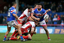 Wakefield Trinity's David Fifita passes the ball as he's tackled during the Betfred Super League match at Belle Vue, Wakefield.