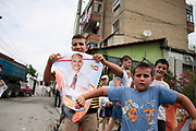 Children holding socialist party branded placards with picture of Albania's Socialist Party leader Edi Rama, attend a rally to supporter his leadership during a electoral campaign rally ahead of the upcoming general election in Tirana, Albania on Sunday, June 21, 2009. Albanians will vote in the legislative elections on 28 June. (Photo by Vudi Xhymshiti)