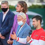 PARIS, FRANCE June 13.   Novak Djokovic of Serbia talks after receiving the winners trophy from former Roland Garros champion Bjorn Borg watched by Jim Courier, Stefanos Tsitsipas of Greece and FFT President Gilles Moretton after the Men's Singles Final at the 2021 French Open Tennis Tournament at Roland Garros on June 13th 2021 in Paris, France. (Photo by Tim Clayton/Corbis via Getty Images)