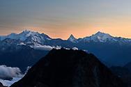 The Michabel group, Matterhorn and Weisshorn are rising over the Bettmerhorn, Aletsch area, Valais, Switzerland