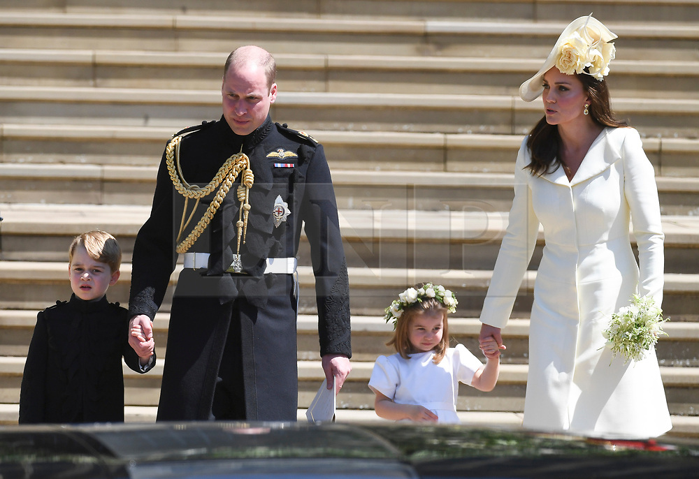 © Licensed to London News Pictures. 19/05/2018. London, UK.  PRINCE GEORGE, PRINCE WILLIAM, PRINCESS CHARLOTTE and CATHERINE, DUCHESS OF CAMBRIDGE at the wedding of Prince Harry, The Duke of Sussex and Meghan Markle, The Duchess of Sussex at St George's Chapel in Windsor Castle. Photo credit: LNP