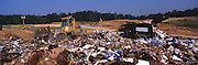 Heavy equipment at work in a sanitary landfill operation.