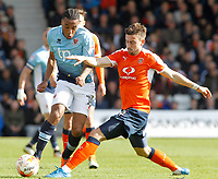 Blackpool's Neil Danns is tackled by Luton Town's Oliver Lee<br /> <br /> Photographer David Shipman/CameraSport<br /> <br /> The EFL Sky Bet League Two - Luton Town v Blackpool - Saturday 1st April 2017 - Kenilworth Road - Luton<br /> <br /> World Copyright © 2017 CameraSport. All rights reserved. 43 Linden Ave. Countesthorpe. Leicester. England. LE8 5PG - Tel: +44 (0) 116 277 4147 - admin@camerasport.com - www.camerasport.com
