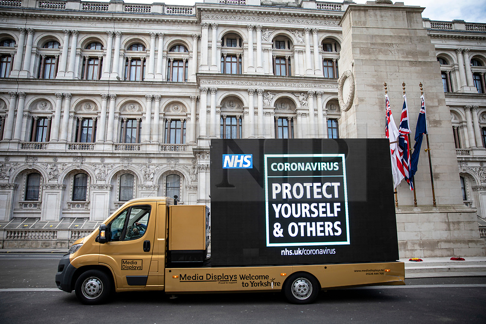 © Licensed to London News Pictures. 20/03/2020. London, UK. An ad van drives past the Cenotaph displaying a message advertising the latest public health advice on the Coronovirus pandemic. Photo credit: Rob Pinney/LNP