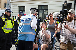 London, UK. 10th June, 2018. Pro-Israel activists, including one in wheelchair, try to block the road in front of the pro-Palestinian Al Quds Day march through central London organised by the Islamic Human Rights Commission. An international event, it began in Iran in 1979. Quds is the Arabic name for Jerusalem.