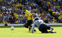 Fotball<br /> Foto: SBI/Digitalsport<br /> NORWAY ONLY<br /> <br /> Watford v Plymouth Argyle<br /> Coca-Cola Championship. 28/08/2004.<br /> <br /> Danny Webber takes the ball past the Argyle keeper, Luke McCormick for his second goal.