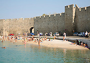 Beach and old town walls, Rhodes town, Greece