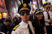 Western men and Japanese women dressed as pilots and cabin crew enjoy the Halloween celebrations in Shibuya. Saturday October 28th 2017