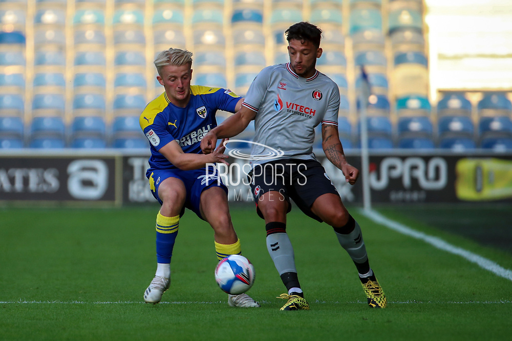 AFC Wimbledon defender Archie Procter (35) battles for possession during the EFL Trophy Group O match between AFC Wimbledon and Charlton Athletic at the Kiyan Prince Foundation Stadium, London, England on 1 September 2020.