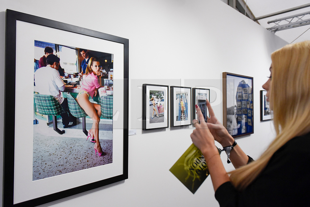 """London, UK.  17 May 2017. A visitor views """"Kate Moss, Los Angeles, CA"""", Vogue, 1995 by Arthur Elgort.  Preview of Photo London 2017 at Somerset House.  Held for the third time, the event showcases the best in contemporary photography, from 89 galleries from 16 different countries, for collectors and enthusiasts and will be on from 18 - 21 May. Credit: Stephen Chung / Alamy Live News"""