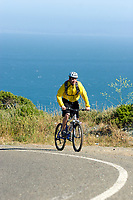 Young man biking Highway 1 near the California Coastal Trail; Golden Gate National Recreation Area. San Francisco,  CA