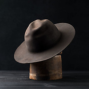 2018 July 13 - New hats from Recapitate Headwear shot in studio on a shared pine table top.