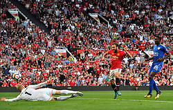 Manchester United's Juan Mata (centre) sees his shot saved by Leicester City goalkeeper Kasper Schmeichel rom close range