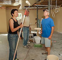 """Sandy McLaughlin and David Zebuhr are prepped and ready to paint at the Children's Charity House """"painting party"""" on Tuesday.  (Karen Bobotas/for the Laconia Daily Sun)"""
