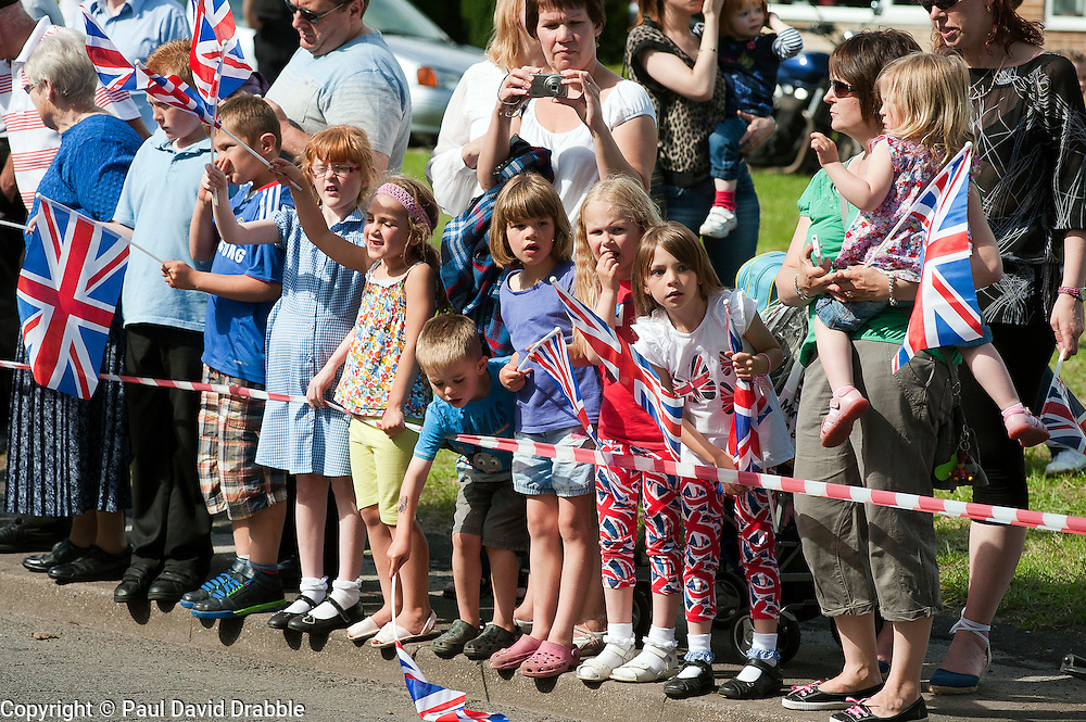 Olympic Torch reaches Sheffield Chapeltown/Ecclesfield/Parson Cross leg.<br /> Children waiting on Cowley Lane for the Torches arrival<br /> 25 June 2012.Image © Paul David Drabble