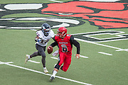 Community College of San Francisco quarterback Zach Modise (8) escapes College of Siskiyous defense at Community College of San Francisco in San Francisco, Calif., on September 10, 2016. (Stan Olszewski/Special to S.F. Examiner)