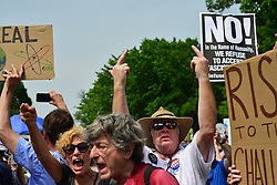 April 29, 2017 - Washington, District of Columbia, United States - Tens of thousands of people gather for the ''People's Climate March'' in Washington DC Saturday, protesting the Trump administration's rollback of environmental protections enacted during the Obama administration. (Credit Image: © Miguel Juarez Lugo via ZUMA Wire)