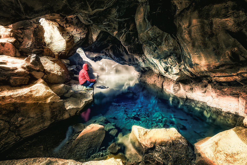Grjotagja Cave with a thermal spring inside in ReykjahlÌ, Iceland