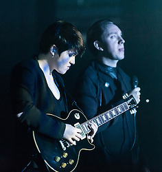 "© Licensed to London News Pictures. 16/12/2012. London, UK.   Romy Madley Croft (left) and Oliver Sim (right) of The XX performing live at O2 Academy Brixton. The xx are an English indie band, formed in London in 2008.  In 2010, the band won the Mercury Music Prize for their debut album, xx.  The band is composed of Romy Madley Croft (vocals, guitar),  Oliver Sim (vocalis, bass) , and .Jamie ""Jamie XX"" Smith (percussion, producer). Photo credit : Richard Isaac/LNP"