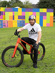 Edinburgh, Scotland, UK. 2 August 2019. Professional Trials riders Danny MacAskill and Duncan Shaw perform tricks on the Meadows. Danny MacAskill's Drop & Roll Live is a main highlight of this year's Underbelly Circus Hub programme. Pictured Danny MacAskill  Iain Masterton/Alamy Live News