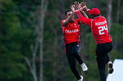 September 22, 2018 - Morrisville, North Carolina, US - Sept. 22, 2018 - Morrisville N.C., USA - Team Canada SAAD ZAFAR (86) celebrates with SRIMANTHA WIJEYERATNE (24) during the ICC World T20 America's ''A'' Qualifier cricket match between USA and Canada. Both teams played to a 140/8 tie with Canada winning the Super Over for the overall win. In addition to USA and Canada, the ICC World T20 America's ''A'' Qualifier also features Belize and Panama in the six-day tournament that ends Sept. 26. (Credit Image: © Timothy L. Hale/ZUMA Wire)