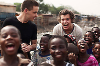 One Direction band members Harry Styles and  visit a rubbish tip in Agbogbloshie slum, Accra