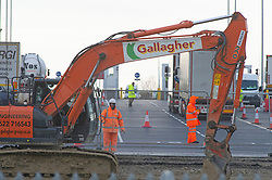 © Licensed to London News Pictures 06/01/2021.         Ashford, UK. Workmen and lorries on site. The Sevington Inland Border Facility in Ashford, Kent has opened its gates to freight traffic heading to Europe. Lorry drivers are receiving Covid-19 tests on part of the site while workmen continue to complete the 66 acre plot which will hold 1700 trucks when finished. Photo credit:Grant Falvey/LNP