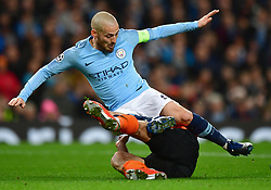 Shakhtar Donetsk''s Taras Stepanenko (right) fouls Manchester City's David Silva and concedes a penalty
