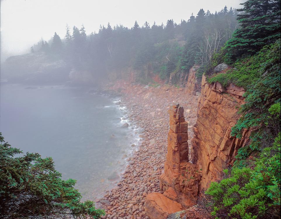 Granite monolith & fog, rocky shoreline, Acadia National Park, ME